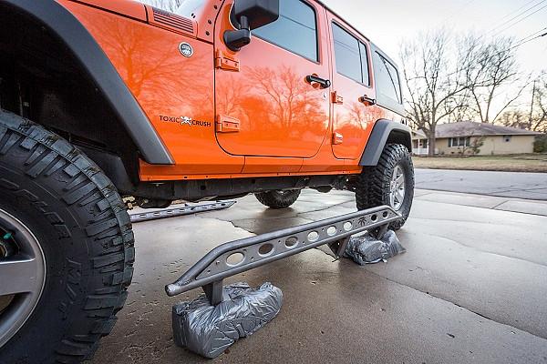 Picture of a Poison Spyder Style Rock Slider for 4-Door Jeep Wrangler JK Black-satin (Set)
